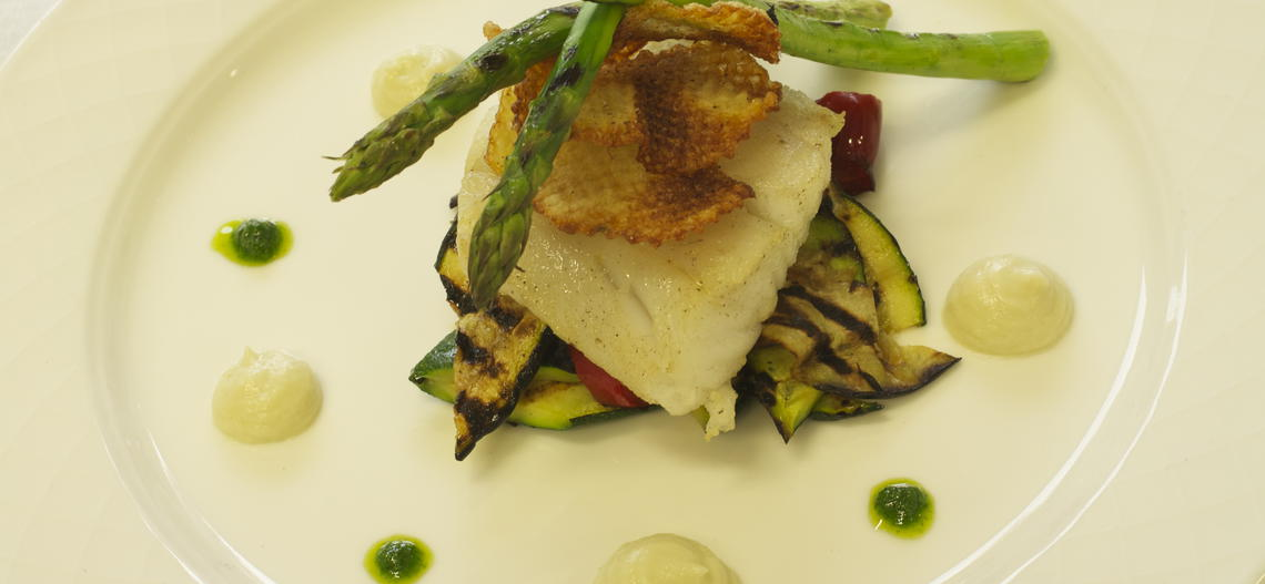 Atlantic pollock with fennel purée, herb coulis and roasted vegetables